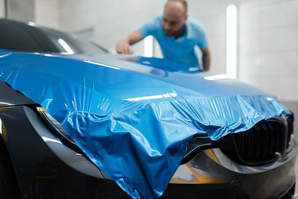 Car wrapping, protective vinyl foil or film on the vehicle, nobody. Auto detailing. Automobile paint protection, professional tuning